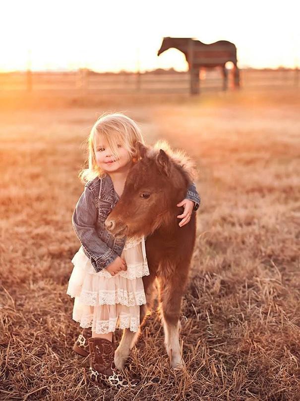 Newborne horse with cute girl